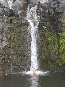 a large waterfall over some water