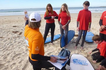 Trainer teaching kids surfing lessons