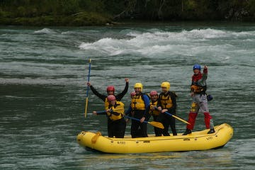 Standing up on a rafting boat