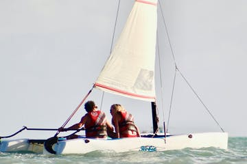 a couple sailing on the Atlantic Ocean in a Hobiecat