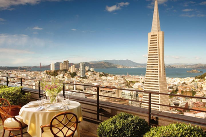 A dinner table with a view of the San Francisco skyline