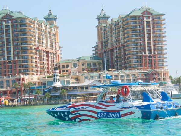 Screaming Eagle speed boat cruising in Destin waters