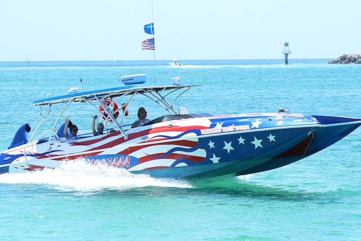 Screaming Eagle speed boat cruising through ocean