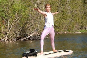 A woman doing yoga on a SUP