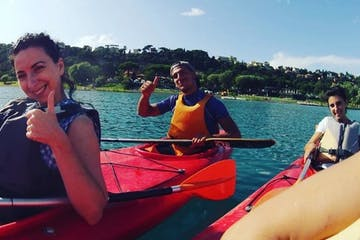 People in kayaks giving thumbs up