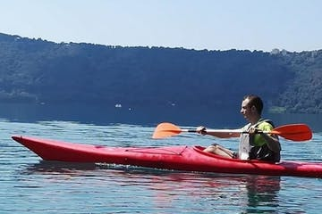 Man in solo red kayak
