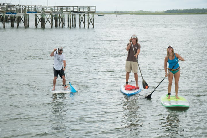 People on a paddle board