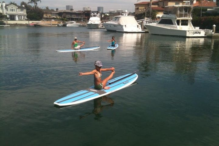 yoga class on paddle board