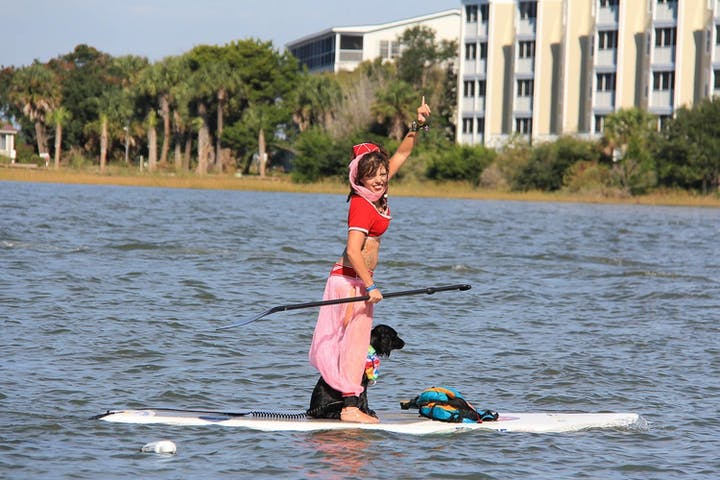 woman in costume on paddle board