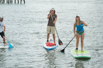 three people on paddle boards