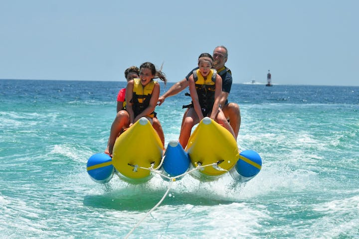 Banana boat riders flying through water