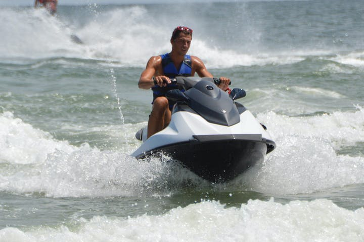 1 guy cruising on a jet ski