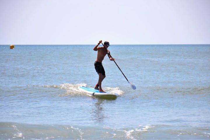 Stand up paddle boarder in the shallows