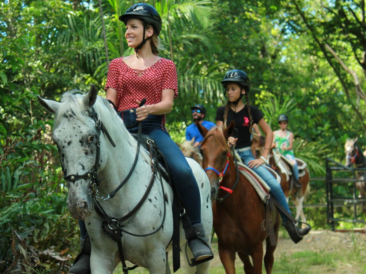 Girl in red shirt riding a white horse