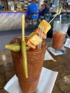 Glass of Custom Crafted Bloody Mary Cocktail with food inserted