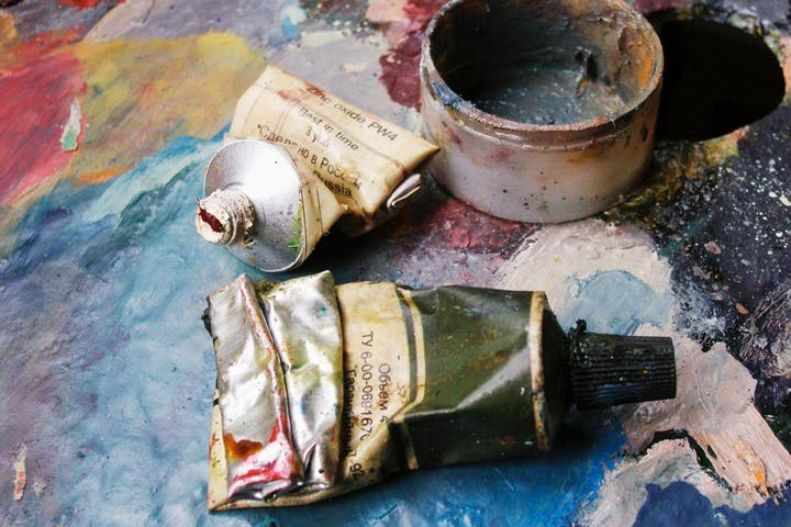 Close up of paints and canvas