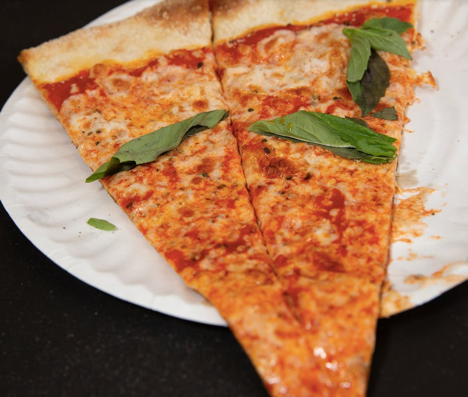 a slice of pizza on a paper plate