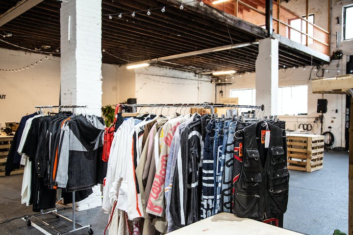 shopping warehouse with rack of clothes in the middle of store