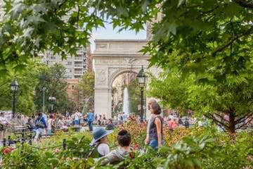 a group of people in washington square park nyc