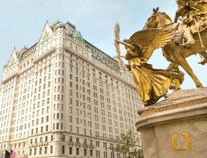 a statue in front of the plaza hotel NYC