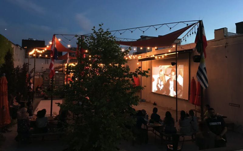a view of an outdoor movie set up