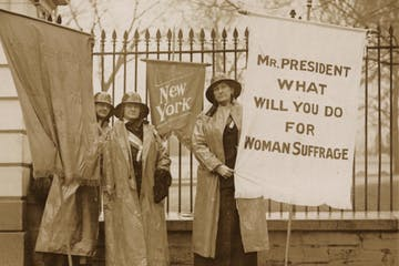 1917 women holding signs for women's suffrage