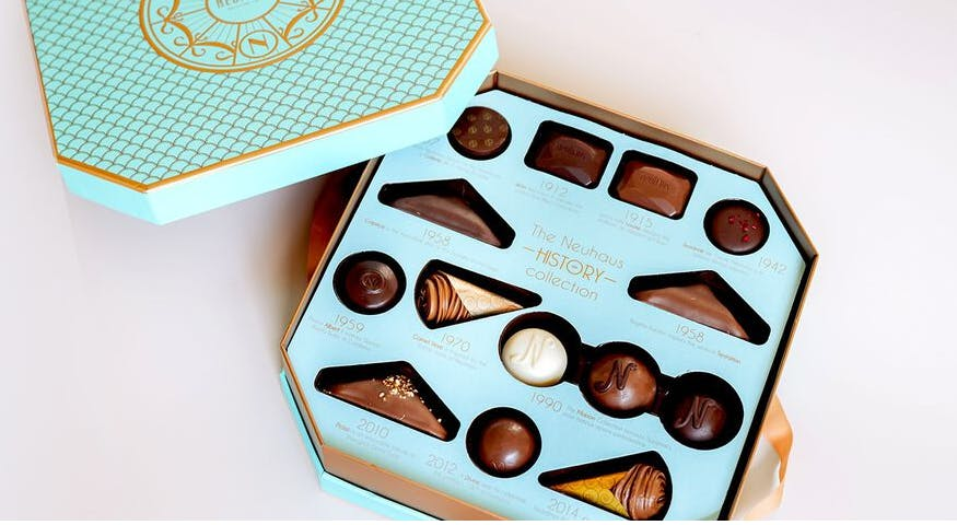 a close up of a box of chocolates