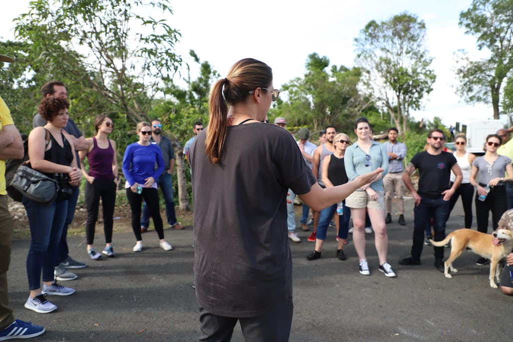 a woman addressing a group of volunteers