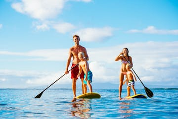 Family doing stand up paddle board