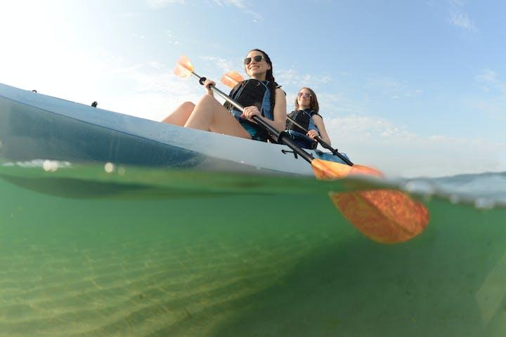 Girls doing kayak on noosa river