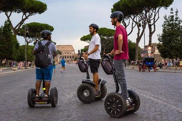 boys riding segways in front of the Colosseum