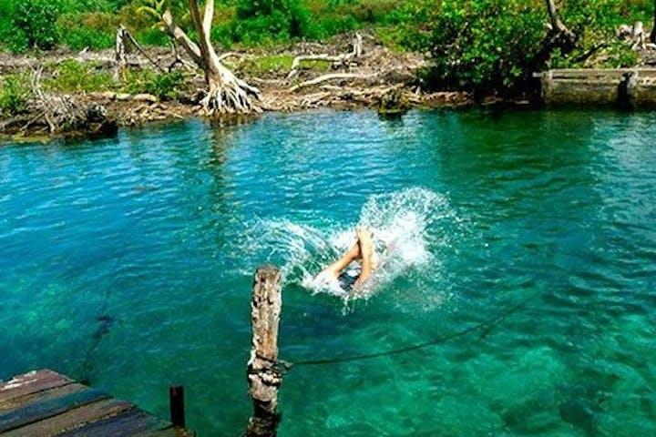 woman swimming at Holbox Island