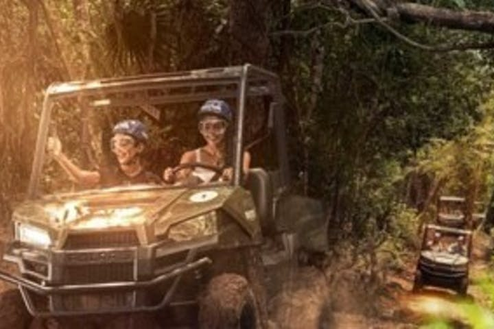 people smiling on ATV ride