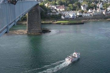 boat going under bridge