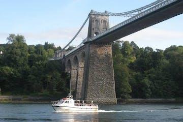 Bridge with boat going under