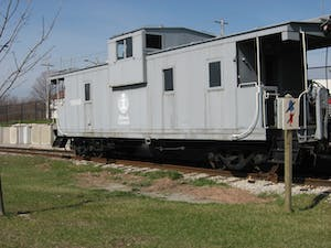 a train is parked on the grass