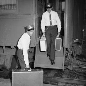 a man standing next to a suitcase
