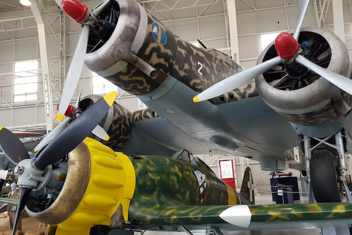 Two historic planes with camouflage