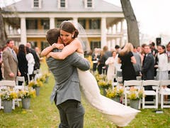 Groom lifts up bride after Houmas House wedding
