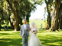 Father walks bride on Houmas House lawn