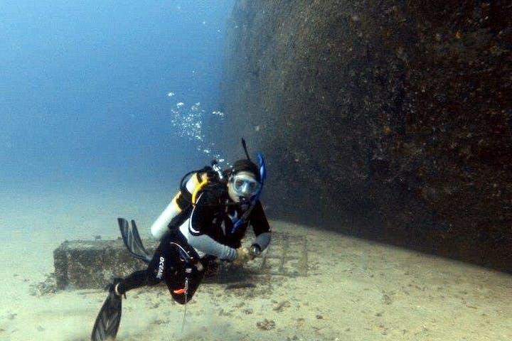 woman owner of Pure Aloha Adventures diving the YO-257 shipwreck off the coast of Honolulu, Hawaii