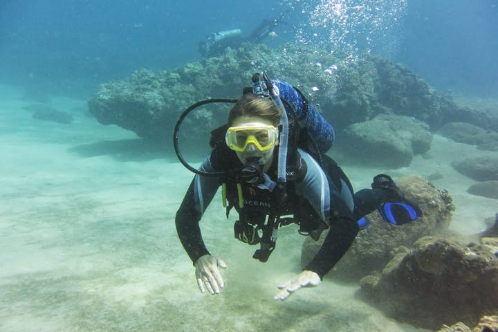 Person scuba diving at Aloha Adventures in Hawaii