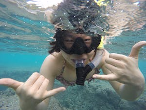 Woman posing while snorkeling at Aloha Adventures in Hawaii