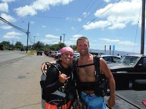 a man and women in scuba diving gear near sharks cove in Hawaii