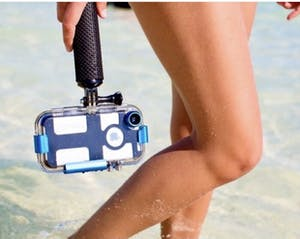 a woman holding an underwater iPhone case near her legs