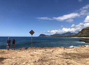 2 people looking at the ocean in hawaii