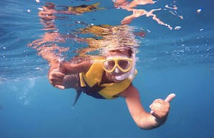 man snorkeling in Hawaii with a lifejacket on