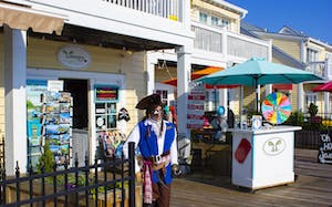 Outside view of Wilmington Water Tours storefront with pirate mannequin featured