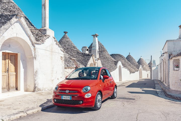 Red Fiat 500 in small town