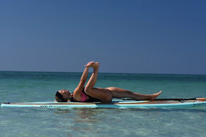 Yoga pose on stand up paddle board